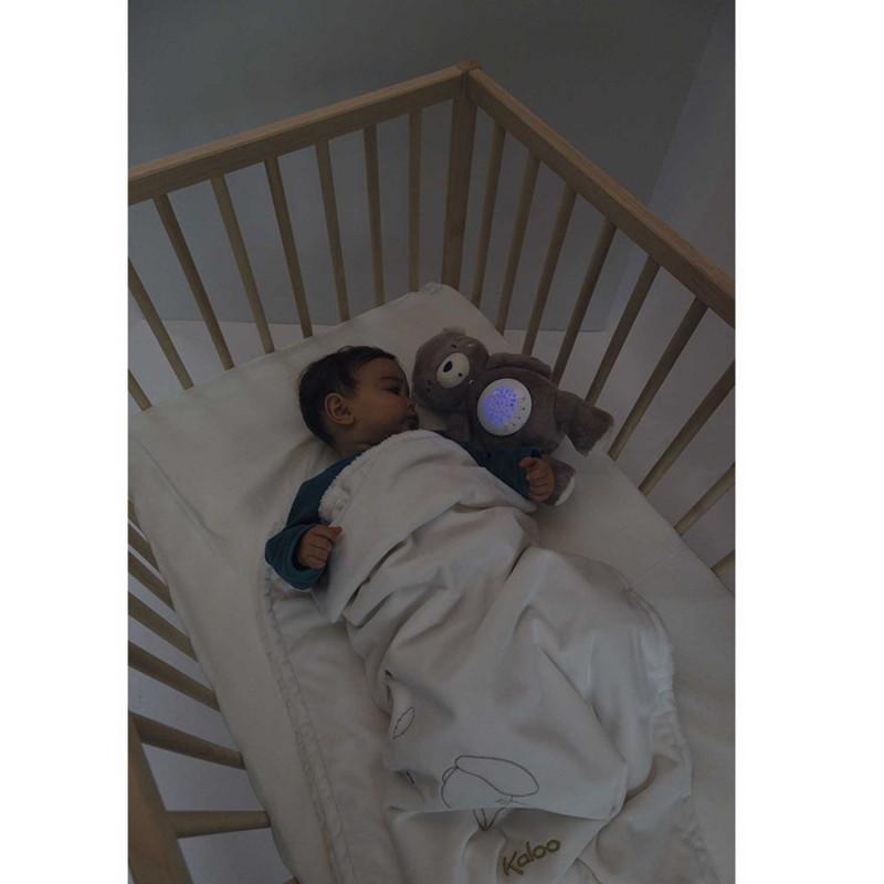 Veilleuse à projection ourson peluche de Kaloo pour les bébés