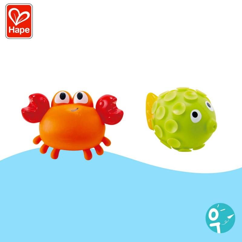 Un crabe et un poisson aspergeurs
