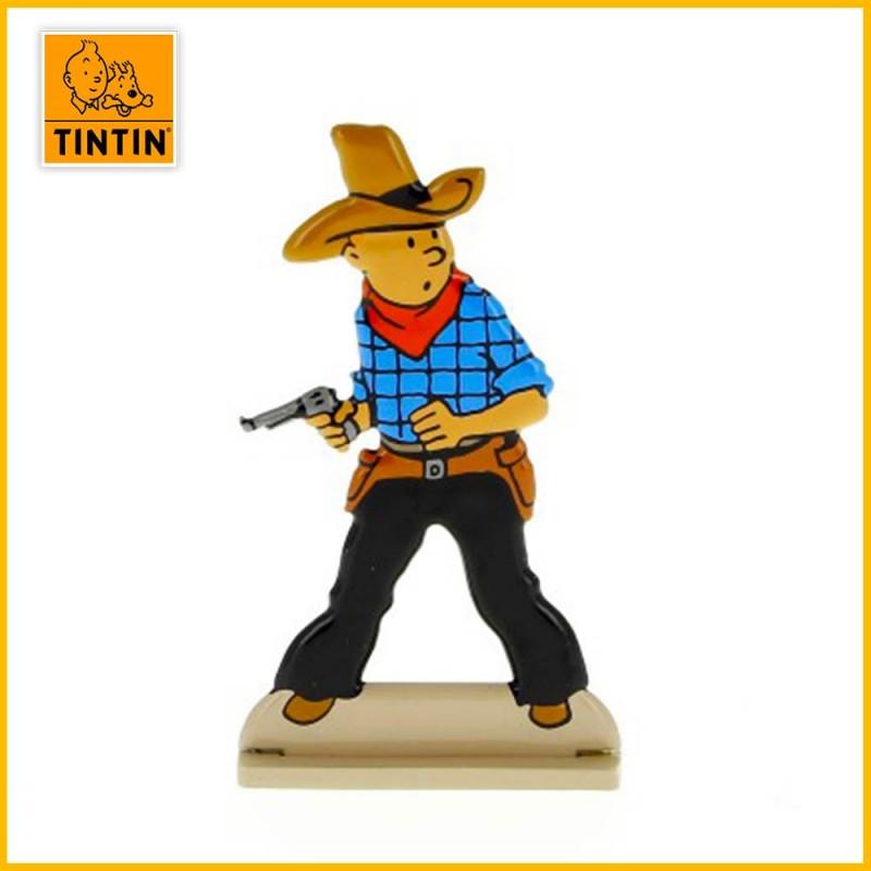 Tintin dégaine son arme pour appréhender le brigand Bobby Smiles.