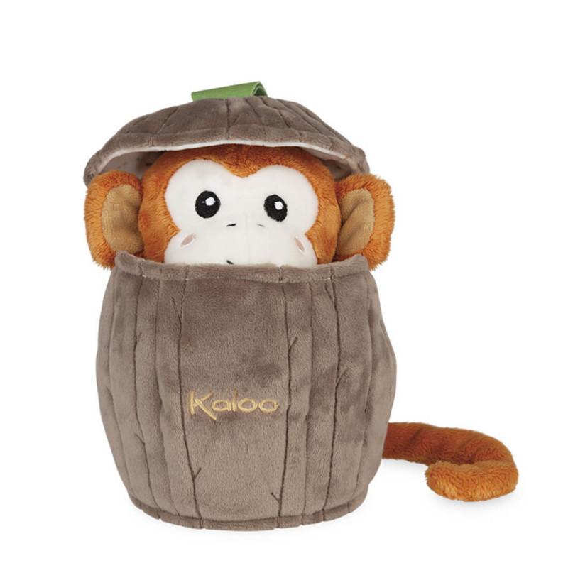 Singe marionnette dans noix de coco en peluche