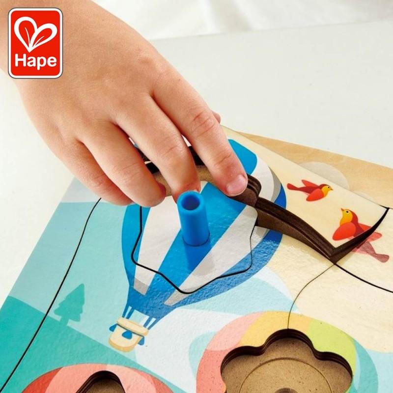 Puzzle montgolfières en bois avec toupies by Hape